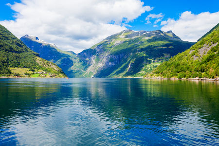 Geirangerfjord mountain view from tourist boat. Geirangerfjord located near the Geiranger village in Norway