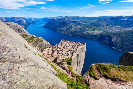 Preikestolen or Prekestolen or Pulpit Rock is a famous tourist attraction near Stavanger, Norway. Preikestolen is a steep cliff which rises above the Lysefjord. Stok Fotoğraf