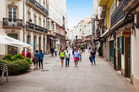 A CORUNA, SPAIN - SEPTEMBER 24, 2017: Tourists at the pedestrian street in the centre of A Coruna in Galicia, Spain Editoriali