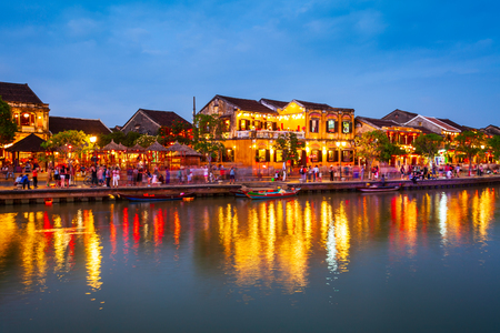Fishing boats at the riverfront of Hoi An ancient town in Quang Nam Province of Vietnam Stock Photo