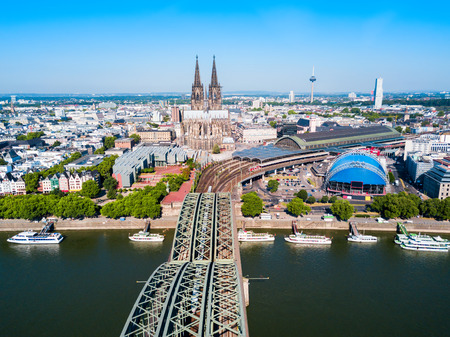 Cologne Cathedral and Hohenzollern Bridge through Rhine river aerial panoramic view in Cologne, Germany Stock Photo