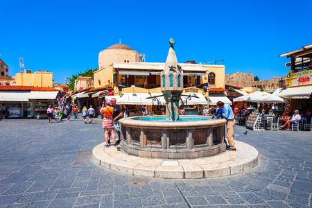 RHODES, GREECE - MAY 13, 2018: Hippocrates fountain at the Rhodes old town main square in Rhodes island in Greece