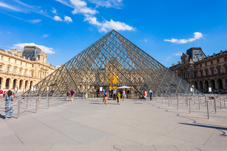 PARIS, FRANCE - SEPTEMBER 12, 2018: Museum of Louvre and its pyramid in the centre of Paris, France