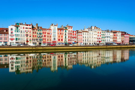 BAYONNE, FRANCE - SEPTEMBER 19, 2018: Colorful houses at the Nive river embankment in Bayonne town in France