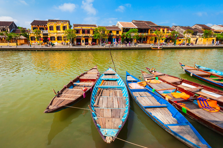 Fishing boats at the riverfront of Hoi An ancient town in Quang Nam Province of Vietnam Stok Fotoğraf