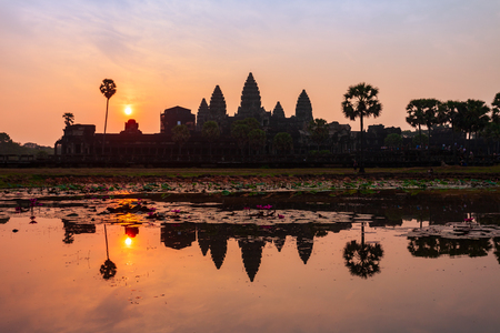 Angkor Wat temple in Siem Reap in Cambodia at sunrise. Angkor Wat is the largest religious monument in the world. Stock Photo