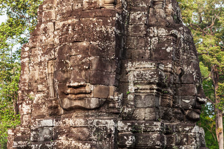 Stone Faces at Bayon Temple. Bayon is a well known khmer temple at Angkor in Cambodia.
