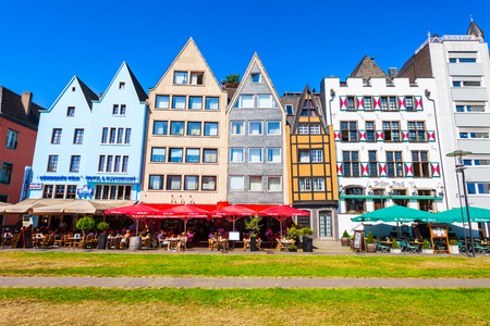 COLOGNE, GERMANY - JUNE 30, 2018: Colorful old houses at the Rhine embankment in the centre of Cologne city in Germany