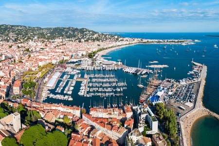 Cannes port aerial panoramic view. Cannes is a city located on the French Riviera or Cote d'Azur in France.