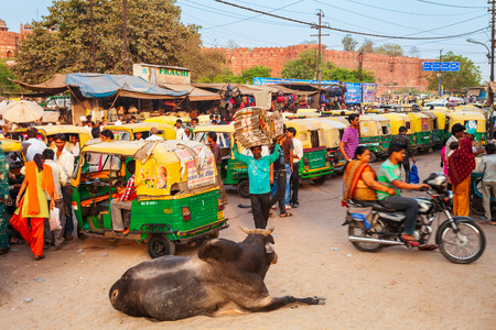 AGRA, INDIA - APRIL 10, 2012: A lot of rickshaws on the street in Agra city, Uttar Pradesh state of India