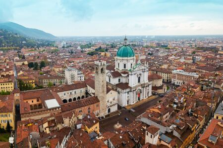New Cathedral or Duomo Nuovo and Old Cathedral or Duomo Vecchio aerial panoramic view in Brescia city in north Italy