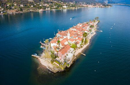 Isola dei Pescatori and Stresa town aerial panoramic view. Isola dei Pescatori or Fishermens island is an island in Lake Maggiore in northern Italy.