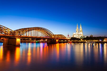 Cologne Cathedral and Hohenzollern Bridge through Rhine river in Cologne, Germany