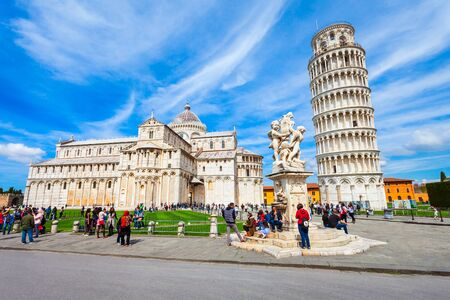 PISA, ITALY - APRIL 06, 2019: Pisa Leaning Tower and Pisa Cathedral at Piazza dei Miracoli or Square of Miracles in Pisa, Italy