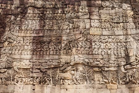 Relief panel at Bayon Temple. Bayon is a well known khmer temple at Angkor in Cambodia. Stock Photo