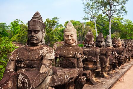 Stone faces at the entrance gate of Bayon Temple. Bayon is a well known khmer temple at Angkor in Cambodia. Stock Photo