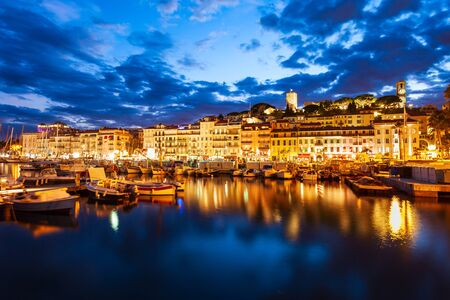 Cannes portl panoramic view at night. Cannes is a city located on the French Riviera or Cote d'Azur in France. Banque d'images - 129568869