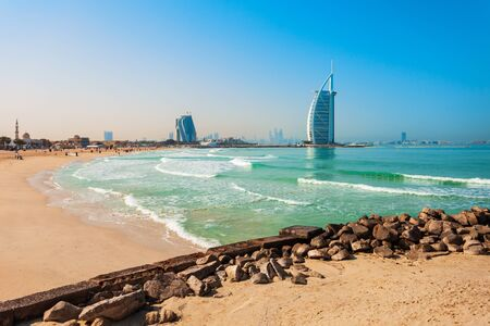 Burj Al Arab luxury hotel and Jumeirah public beach in Dubai city in UAE Imagens