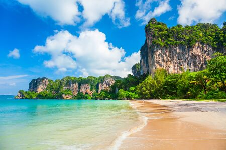 Beauty beach with yellow sand and crystal clear water in Thailand Archivio Fotografico - 129469961