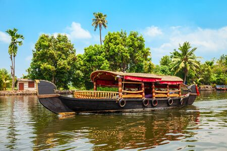 A houseboat sailing in Alappuzha backwaters in Kerala state in India Stock Photo