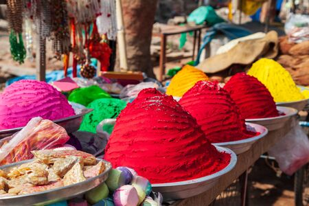 Plates with holi powder colors at the local market in India Stock Photo