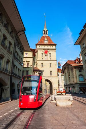 Kafigturm is a landmark medieval clock tower and red tram in Bern city in Switzerland