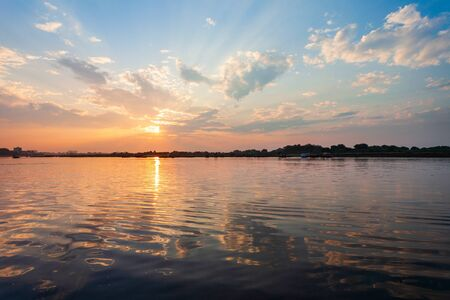 Sunset at the Keshi Ghat on Yamuna river in Vrindavan city in Uttar Pradesh state of India Stock Photo