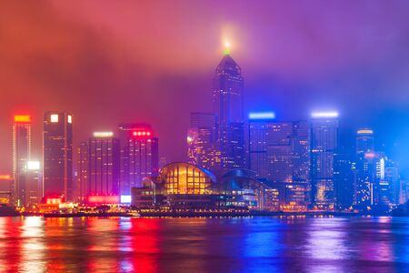 Hong Kong Island skyline viewed from the Victoria Harbour waterfront. Hong Kong is a city and special region of China. Stockfoto