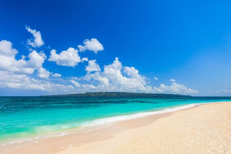 Tropical vacation at lonely white sand beach in Boracay island in Philippines