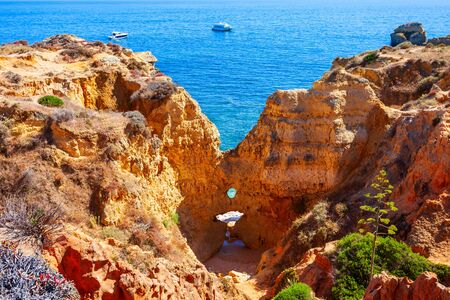 Sao Rafael beach with beauty limestone cliff aerial view, Albufeira city in Algarve region, Portugal