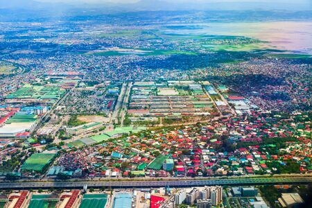 Manila suburb with small houses aerial panoramic view from the plane, Philippines