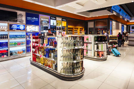 DUBAI, UAE - MARCH 02, 2019: Alcohol shop in the duty free zone in the Dubai International Airport in UAE Редакционное
