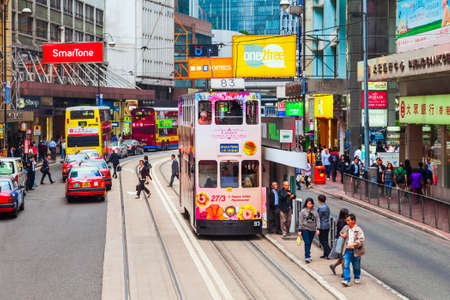 HONG KONG - MARCH 19, 2013: Double decker tramway or tram is a symbol of Hong Kong city in China