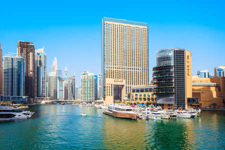 DUBAI, UAE - FEBRUARY 25, 2019: Dubai Marina is an artificial canal city and a district in Dubai in UAE Редакционное
