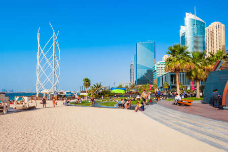 DUBAI, UAE - FEBRUARY 25, 2019: JBR or Jumeirah Beach Residence is a waterfront community located in Dubai Marina in UAE Редакционное