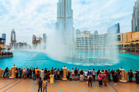 DUBAI, UAE - FEBRUARY 25, 2019: Dubai fountain and Burj Khalifa Tower, a skyscraper and the tallest building in the world in Dubai, UAE