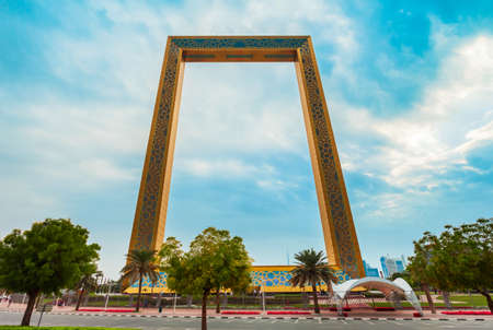 DUBAI, UAE - FEBRUARY 27, 2019: Dubai Frame is an architectural landmark located in Zabeel Park in Dubai city in UAE Редакционное