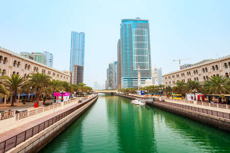SHARJAH, UAE - MARCH 01, 2019: Al Qasba canal promenade in the Sharjah city centre in United Arab Emirates or UAE