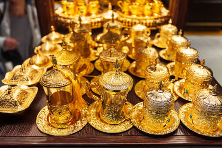 DUBAI, UAE - MARCH 02, 2019: Traditional arabic tea pot souvenir in the duty free zone in the Dubai International Airport in UAE