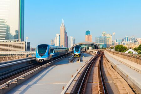 Dubai Metro train and Dubai city skyline in UAE