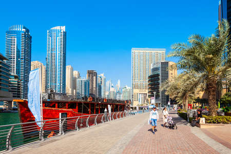 DUBAI, UAE - FEBRUARY 26, 2019: Dubai Marina is an artificial canal city and a district in Dubai in UAE Редакционное