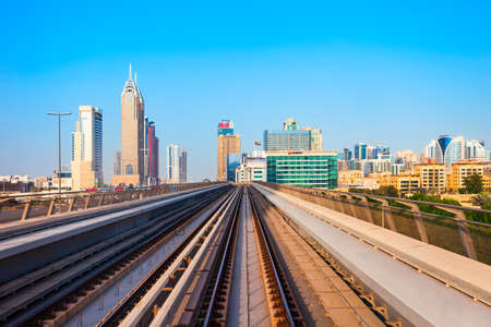 DUBAI, UAE - FEBRUARY 25, 2019: Dubai Metro train track and Dubai city skyline in UAE