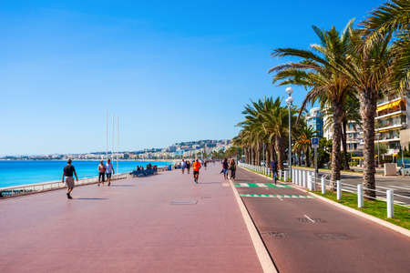 NICE, FRANCE - SEPTEMBER 27, 2018: The Promenade des Anglais is a promenade along the Mediterranean at Nice city, Cote d'Azur region in France