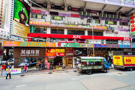 HONG KONG - FEBRUARY 22, 2013: Signboards with advertisement on a small shopping street in Hong Kong.