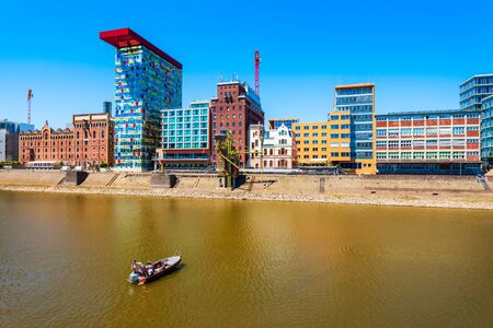 Medienhafen or media harbor is a rebuilt port area in Dusseldorf city in Germany Banco de Imagens