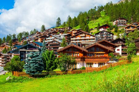 Traditional local houses in the centre of Zermatt town in the Valais canton of Switzerland