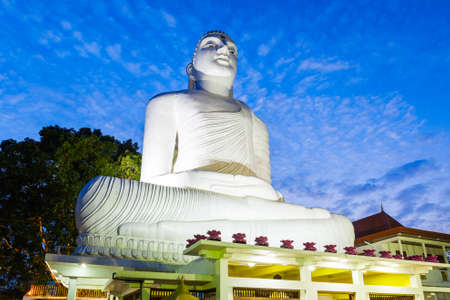 Bahirawa Kanda or Bahirawakanda Vihara Buddha Statue in Kandy, Sri Lanka at sunset. Bahirawakanda is a giant samadhi buddha statue on the top of the mountain in Kandy.