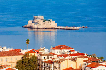 Bourtzi is a water castle located in the middle of Nafplio harbour. Nafplio is a seaport town in the Peloponnese peninsula in Greece. 에디토리얼