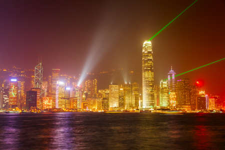 Hong Kong Island skyline with light show viewed from the Victoria Harbour waterfront. Hong Kong is a city and special region of China.