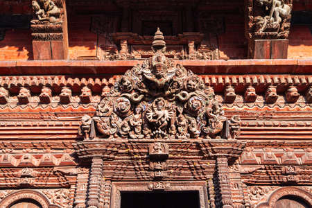 Relief carving on a hindu temple at the Patan Durbar Square in Lalitpur or historically Patan city near in Kathmandu in Nepal